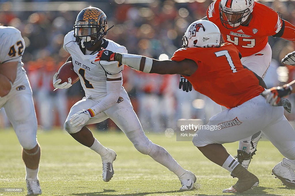 Dri Archer #1 of the Kent State Golden Flashes slips past D.J. Lynch #7 of the Bowling Green Falcons on November 17, 2012 at Doyt Perry Stadium in Bowling Green, Ohio. Kent State defeated Bowling Green 31-24.