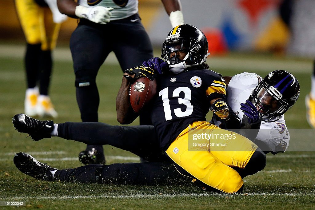 <a gi-track='captionPersonalityLinkClicked' href=/galleries/search?phrase=Dri+Archer&family=editorial&specificpeople=9689813 ng-click='$event.stopPropagation()'>Dri Archer</a> #13 of the Pittsburgh Steelers is tackled by <a gi-track='captionPersonalityLinkClicked' href=/galleries/search?phrase=C.J.+Mosley+-+Jugador+de+f%C3%BAtbol+americano+-+Linebacker&family=editorial&specificpeople=11330425 ng-click='$event.stopPropagation()'>C.J. Mosley</a> #57 of the Baltimore Ravens during their AFC Wild Card game at Heinz Field on January 3, 2015 in Pittsburgh, Pennsylvania.