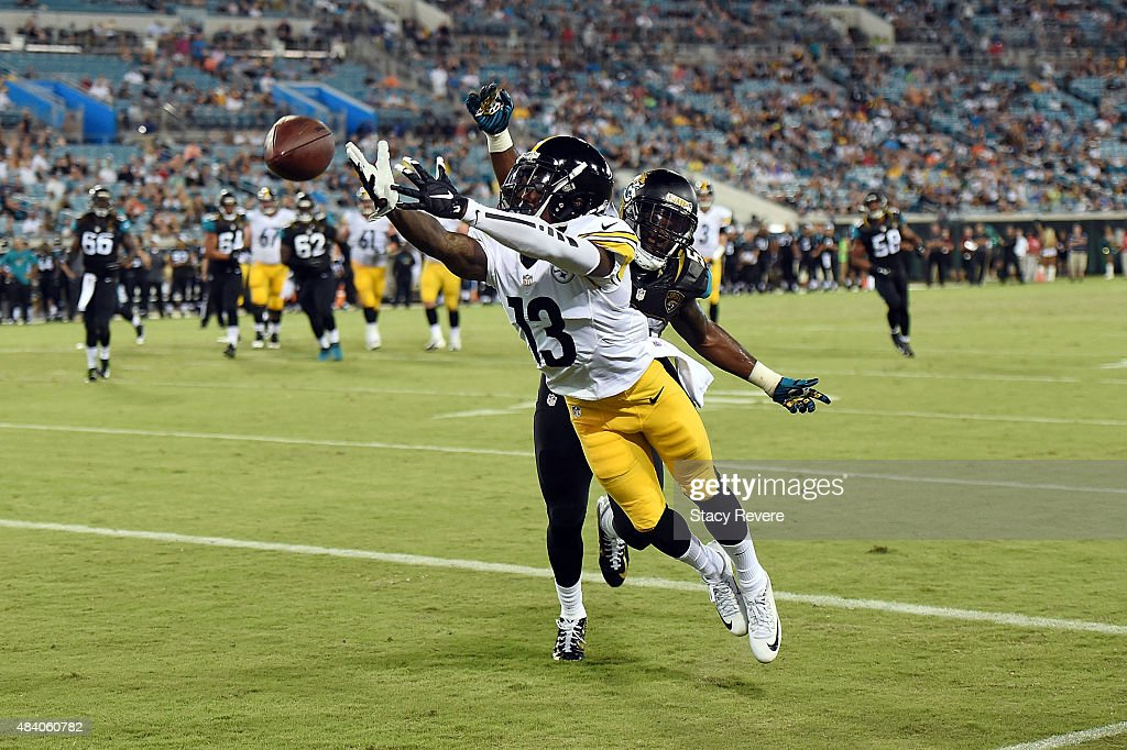 <a gi-track='captionPersonalityLinkClicked' href=/galleries/search?phrase=Dri+Archer&family=editorial&specificpeople=9689813 ng-click='$event.stopPropagation()'>Dri Archer</a> #13 of the Pittsburgh Steelers is unable to catch a pass in front of <a gi-track='captionPersonalityLinkClicked' href=/galleries/search?phrase=LaRoy+Reynolds&family=editorial&specificpeople=7319244 ng-click='$event.stopPropagation()'>LaRoy Reynolds</a> #52 of the Jacksonville Jaguars during a preseason game at EverBank Field on August 14, 2015 in Jacksonville, Florida.