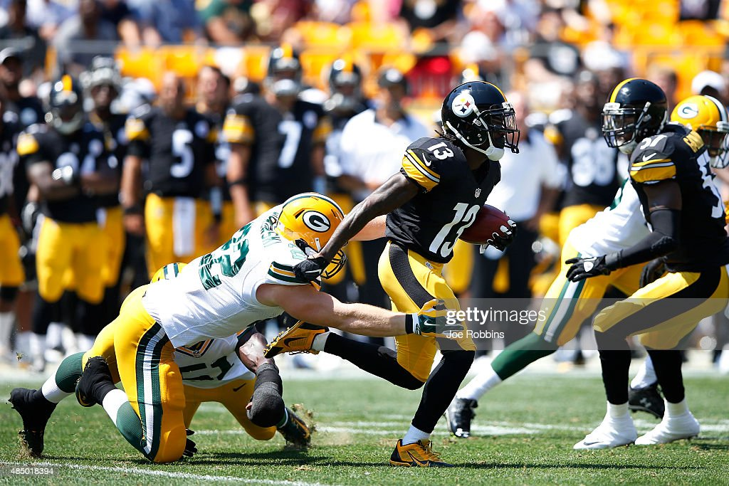 Dri Archer #13 of the Pittsburgh Steelers returns a kickoff in the first half of a preseason game against the Green Bay Packers at Heinz Field on August 23, 2015 in Pittsburgh, Pennsylvania.