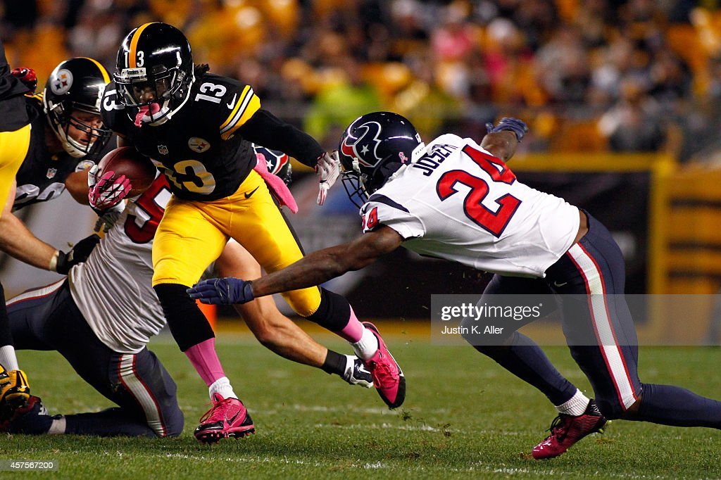 <a gi-track='captionPersonalityLinkClicked' href=/galleries/search?phrase=Dri+Archer&family=editorial&specificpeople=9689813 ng-click='$event.stopPropagation()'>Dri Archer</a> #13 of the Pittsburgh Steelers runs the ball against <a gi-track='captionPersonalityLinkClicked' href=/galleries/search?phrase=Johnathan+Joseph+-+American+Football+Player&family=editorial&specificpeople=9856905 ng-click='$event.stopPropagation()'>Johnathan Joseph</a> #24 of the Houston Texans during their game at Heinz Field on October 20, 2014 in Pittsburgh, Pennsylvania.