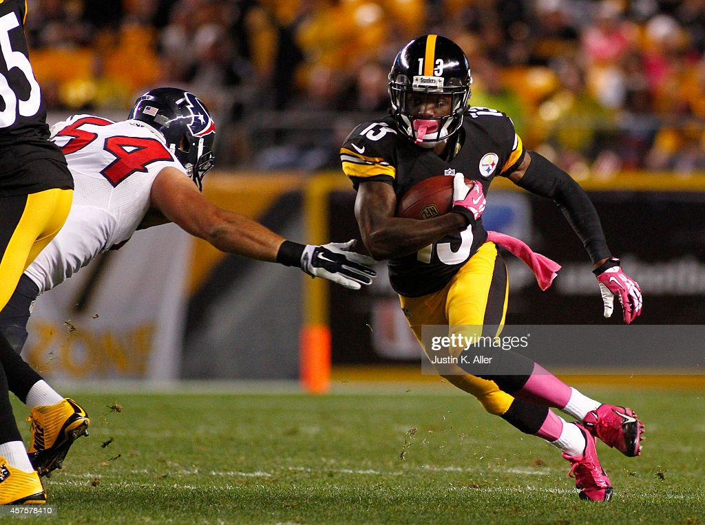 Dri Archer #13 of the Pittsburgh Steelers rushes during the game against Mike Mohamed #54 of the Houston Texans on October 20, 2014 at Heinz Field in Pittsburgh, Pennsylvania.