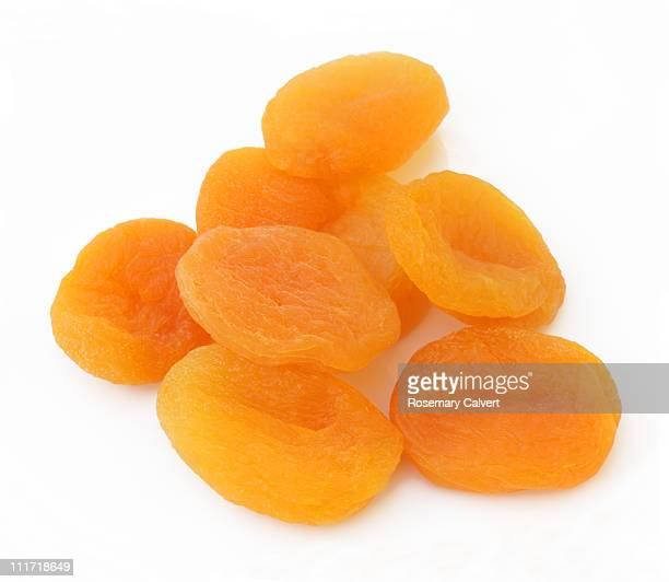 Dried apricots in pile.