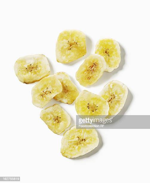 Dried banana slices on white background