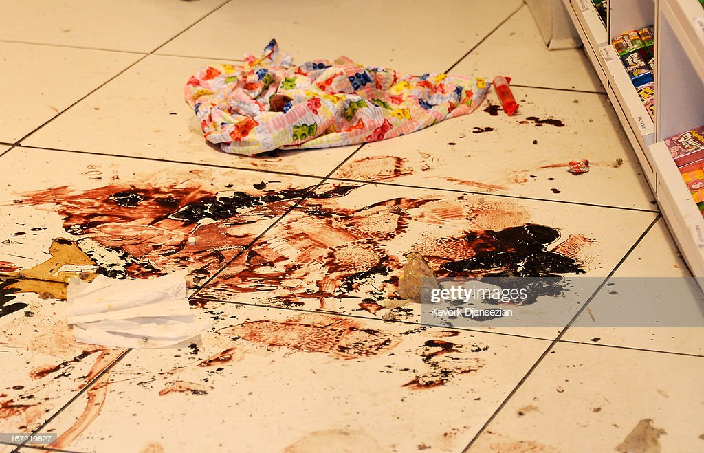 Dried blood trails are still visible inside the Sugar Heavan store near the finish line of the Boston Marathon on April 22, 2013 in Boston, Massachusetts. The FBI handed Boylston Street back to the city one week after the bombings. A manhunt ended for Dzhokhar A. Tsarnaev, 19, a suspect in the Boston Marathon bombing after he was apprehended on a boat parked on a residential property in Watertown, Massachusetts. His brother Tamerlan Tsarnaev, 26, the other suspect, was shot and killed after a car chase and shootout with police. The bombing, on April 15 at the finish line of the marathon, killed three people and wounded at least 170.