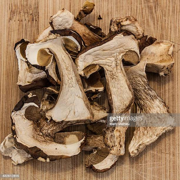 Dried ceps on wooden board