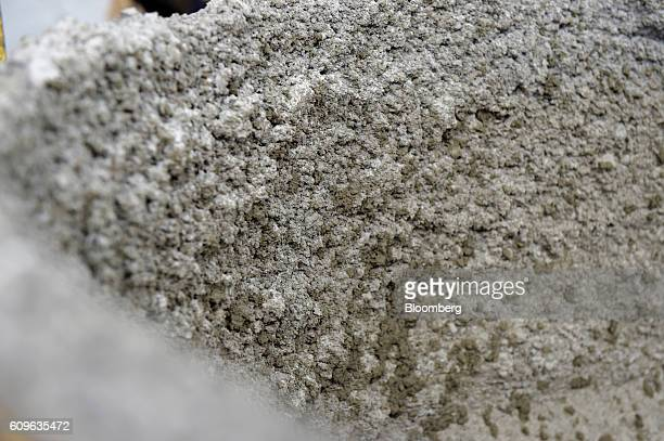 Dried concrete forms a crust around a cement mixer at Gully Concrete supplies in Melbourne Australia on Tuesday Aug 16 2016 Australia's economy is...