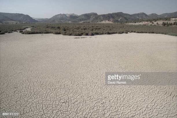 Dried cracked mud is seen at the Valdeinfierno reservoir on July 28 2017 in Zarcilla de Ramos Spain Valdeinfierno is one of the Spain's oldest...
