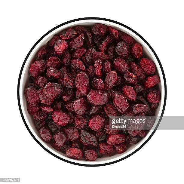 Dried cranberries on a bowl from directly above