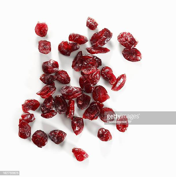 Dried cranberries on white background