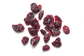 closeup of dried cranberries on white background