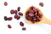 dried cranberry in a wooden spoon