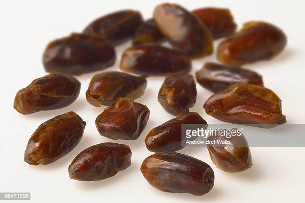 dried date fruits on a white background