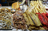 Various kinds of dried and preserved fish on sale