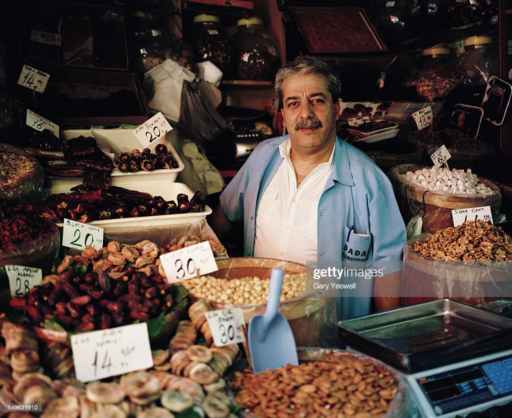 Dried fruit and nut seller in the Spice Market : Stock Photo