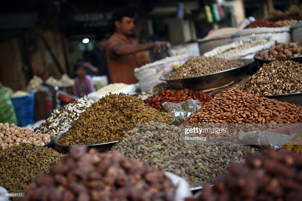 Dried fruit and nuts are displayed for sale in Jodia Bazar in Karachi, Pakistan, on Wednesday, Oct. 31, 2012. Businesses in Pakistan's commercial capital are bracing for a surge in extortion demands as parties representing the city's ethnic communities seek to use their hired guns to build financial war chests ahead of parliamentary polls due in the first half of next year. Photographer: Asim Hafeez/Bloomberg via Getty Images