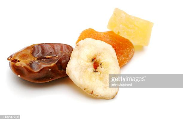dried fruit pieces, healthly snack against white