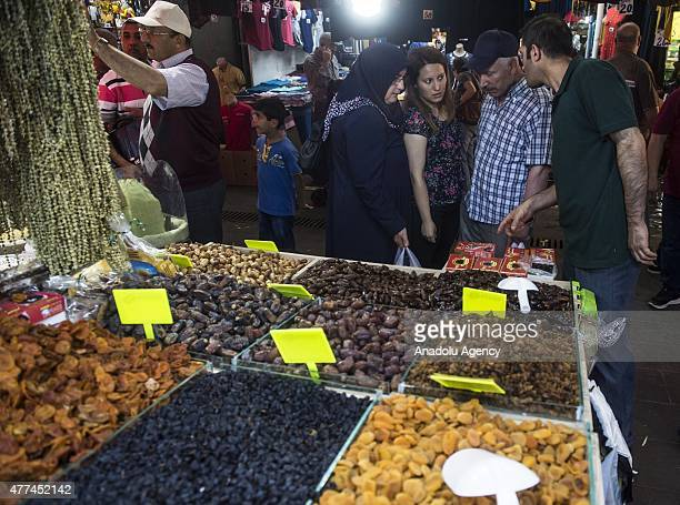 Dried fruits are seen at Ulus wholesale market hall as Turkish people make their preparations ahead of the holy month of Ramadan on June 17 2015 in...