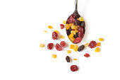 Dried fruits on white background - isolated (Cranberry, raisin and orange)