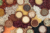Dried health food background with smart carbs of pulses, grains, seeds and cereals. Super foods high in vitamins, antioxidants, omega 3, anthocyanins, minerals and fibre. Top view.