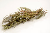 bound and dried herbs on a light background