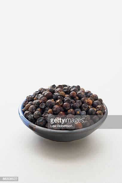 Dried juniper berries in bowl