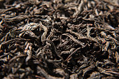 Dried leaves of black tea background. Macro photo - top view