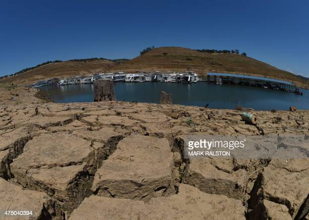 Dried mud and the remnants of a marina at the New Melones Lake reservoir which is now at less than 20% capacity as a severe drought continues to...