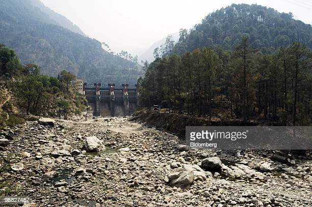A dried out river bed sits near the site of one of 200 proposed dams along the Ganges River in the town of Uttarksahi Uttarkhand India on Thursday...