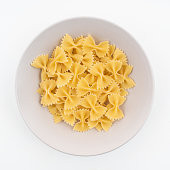 Some dried butterfly format pasta on a plate