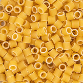 some small pieces of dried pasta as a background