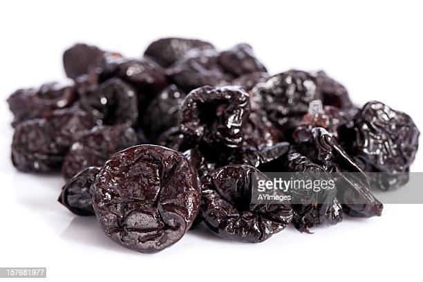 Dried prunes on white background