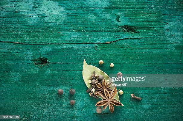 Dried spices on green wood