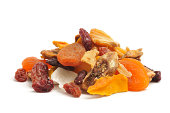 A close up shot of a mix of dried tropical fruit isolated on a white background.