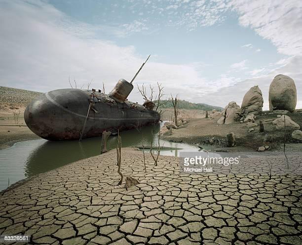 Dried up dam with submarine