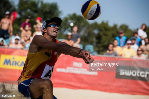 Dries Koekelkoren of Belgium receives the ball during the match against Bartosz Losiak and Piotr Kantor of Poland at FIVB Beach Volleyball World...