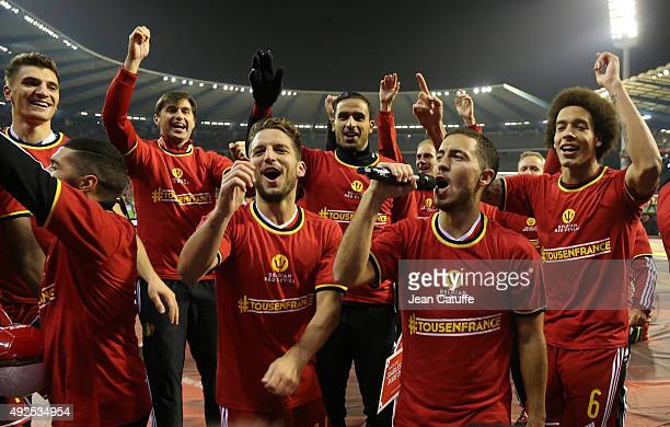 Dries Mertens Eden Hazard Axel Witsel of Belgium and teammates celebrate with the fans their qualification for the Euro 2016 at the end of the UEFA...