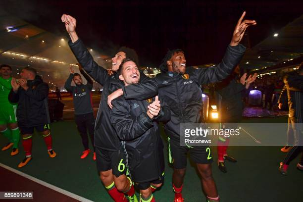 Dries Mertens forward of Belgium Axel Witsel midfielder of Belgium and Michy Batshuayi forward of Belgium celebrating the qualification for the World...