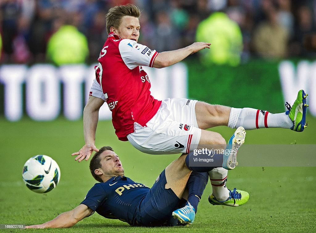 Dries Mertens (L), Mattias Johannson (R) during the Dutch Cup final match between AZ Alkmaar and PSV Eindhoven on May 9, 2013 at the Kuip stadium in Rotterdam, The Netherlands.