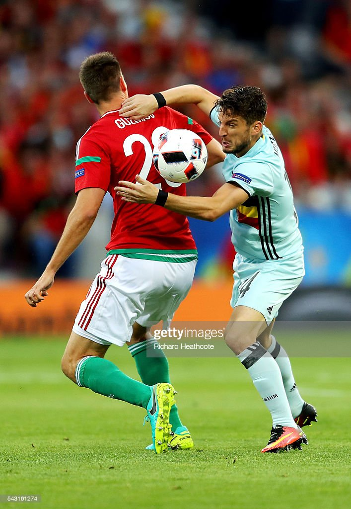 <a gi-track='captionPersonalityLinkClicked' href=/galleries/search?phrase=Dries+Mertens&family=editorial&specificpeople=6524919 ng-click='$event.stopPropagation()'>Dries Mertens</a> of Belgium and Richard Guzmics of Hungary compete for the ball during the UEFA EURO 2016 round of 16 match between Hungary and Belgium at Stadium Municipal on June 26, 2016 in Toulouse, France.