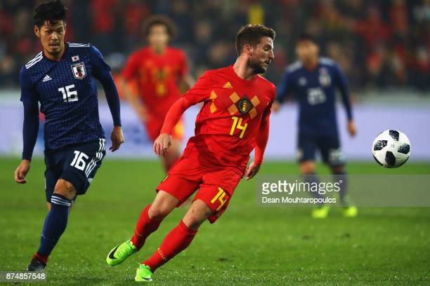 Dries Mertens of Belgium battles for the ball with Yuya Osako of Japan during the international friendly match between Belgium and Japan held at Jan...