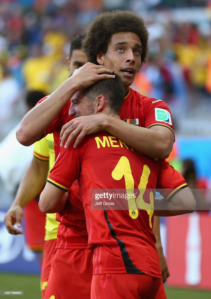 <a gi-track='captionPersonalityLinkClicked' href=/galleries/search?phrase=Dries+Mertens&family=editorial&specificpeople=6524919 ng-click='$event.stopPropagation()'>Dries Mertens</a> #14 of Belgium celebrates scoring his team's second goal with <a gi-track='captionPersonalityLinkClicked' href=/galleries/search?phrase=Axel+Witsel&family=editorial&specificpeople=4345455 ng-click='$event.stopPropagation()'>Axel Witsel</a> during the 2014 FIFA World Cup Brazil Group H match between Belgium and Algeria at Estadio Mineirao on June 17, 2014 in Belo Horizonte, Brazil.