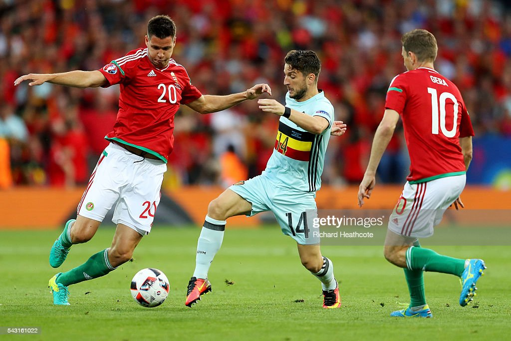 Dries Mertens (C) of Belgium competes for the ball against Richard Guzmics (L) and Zoltan Gera (R) of Hungary during the UEFA EURO 2016 round of 16 match between Hungary and Belgium at Stadium Municipal on June 26, 2016 in Toulouse, France.