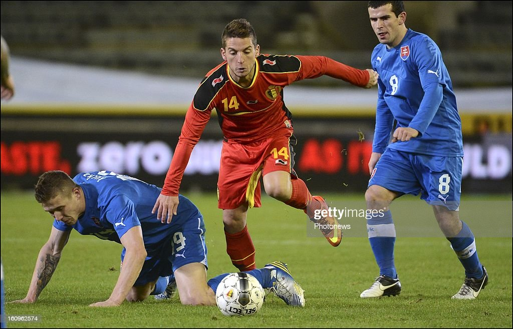 Dries Mertens of Belgium evades a tackle during a FIFA international friendly match in preparation of the World Cup qualifying round between Belgium and Slovakia at the Jan Breydel stadium on February 6, 2013 in Brugge, Belgium
