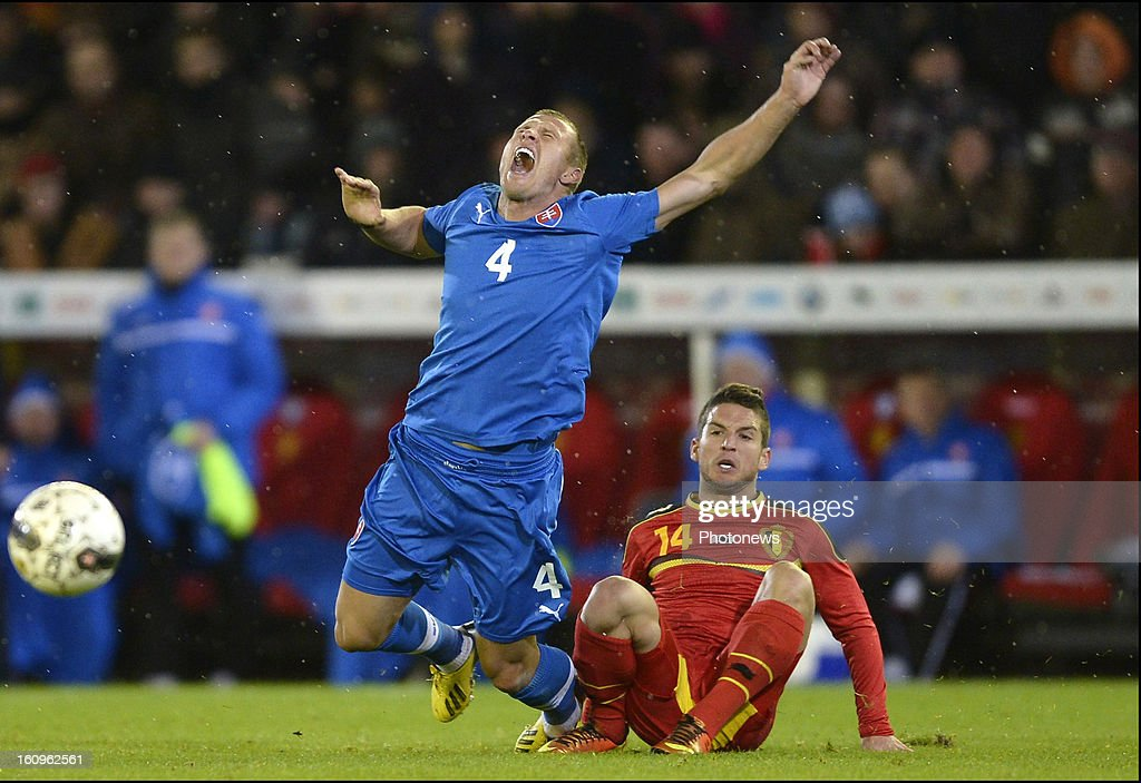 <a gi-track='captionPersonalityLinkClicked' href=/galleries/search?phrase=Dries+Mertens&family=editorial&specificpeople=6524919 ng-click='$event.stopPropagation()'>Dries Mertens</a> of Belgium tackles <a gi-track='captionPersonalityLinkClicked' href=/galleries/search?phrase=Jan+Durica&family=editorial&specificpeople=765416 ng-click='$event.stopPropagation()'>Jan Durica</a> of Slovakia during a FIFA international friendly match between Belgium and Slovakia at theJan Breydel stadium on February 06, 2013 in Brugge, Belgium