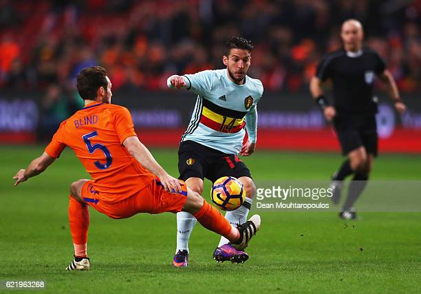 Dries Mertens of Belgium takes on Daley Blind of the Netherlands during the international friendly match between Netherlands and Belgium at Amsterdam...