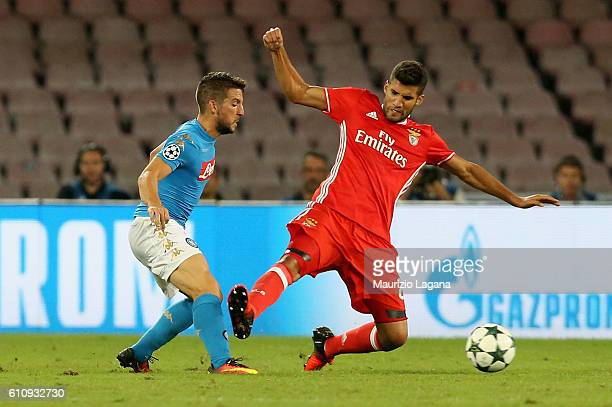 Dries Mertens of Napoli competes for the ball with Lisandro Lopez of Benfica during the UEFA Champions League match between SSC Napoli and Benfica at...