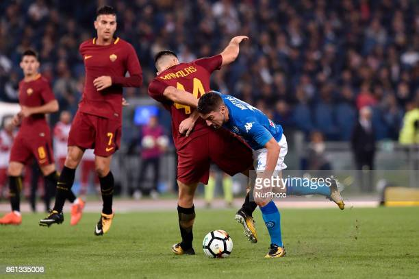 Dries Mertens of Napoli is challenged by Konstantinos Manolas of Roma during the Serie A match between Roma and Napoli at Olympic Stadium Roma Italy...