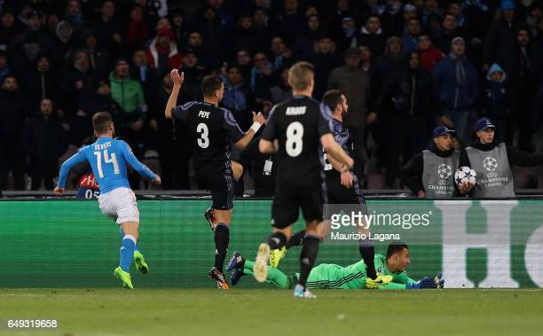Dries Mertens of Napoli scores the opening goal during the UEFA Champions League Round of 16 second leg match between SSC Napoli and Real Madrid CF...