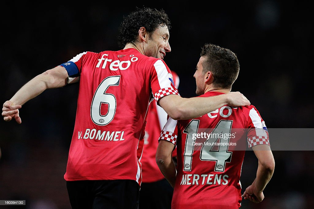 <a gi-track='captionPersonalityLinkClicked' href=/galleries/search?phrase=Dries+Mertens&family=editorial&specificpeople=6524919 ng-click='$event.stopPropagation()'>Dries Mertens</a> (R) of PSV celebrates scoring the first goal of the game with team mate <a gi-track='captionPersonalityLinkClicked' href=/galleries/search?phrase=Mark+Van+Bommel&family=editorial&specificpeople=221166 ng-click='$event.stopPropagation()'>Mark Van Bommel</a> during the KNVB Dutch Cup match between PSV Eindhoven and Feyenoord Rotterdam at Philips Stadion on January 30, 2013 in Eindhoven, Netherlands.
